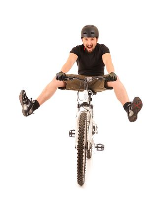 rapidity: Fun bicyclist isolated on white, studio shot.