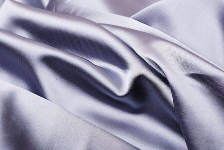 Smooth elegant blue satin background photo