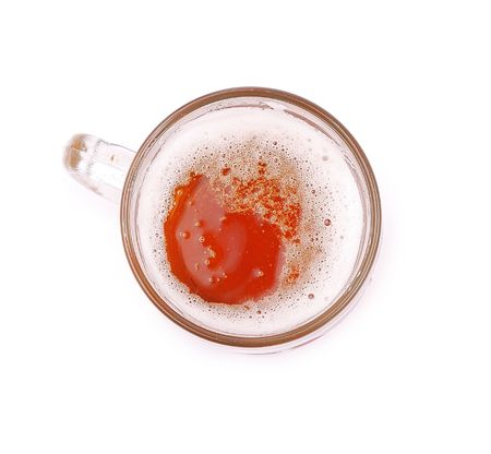 glass of beer on a white background, top view photo