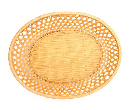 Empty fruit or bread basket on white, top view. photo