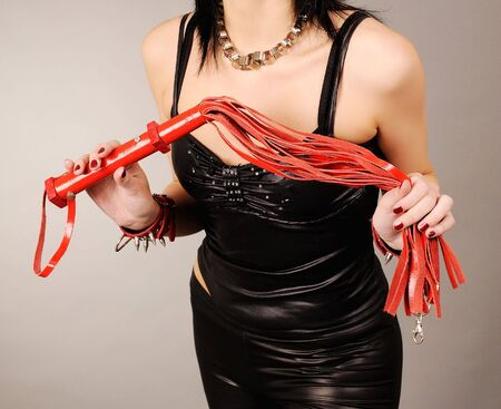 Female hands with leather whip photo