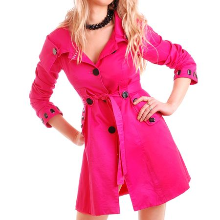 woman in pink coat on white background photo