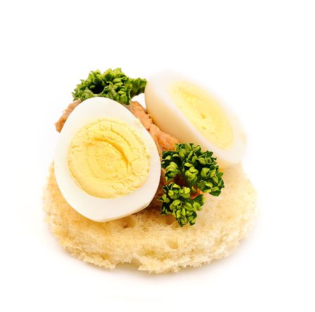 sandwich on wheat bread with quail egg, paste and parsley photo