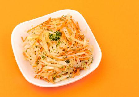 Fresh vegetable vegetarian salad on orange photo
