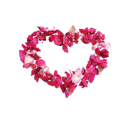 Framework in the form of heart made of petals photo