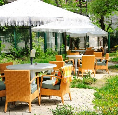 outdoor cafe: Romantic summer outdoor cafe terrace Stock Photo