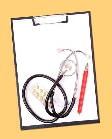 Medical clipboard and stethoscope on yellow Stock Photo - 6991148