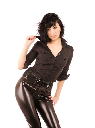 young beautiful female in black leather leggings isolated on white  Stock Photo - 6987849