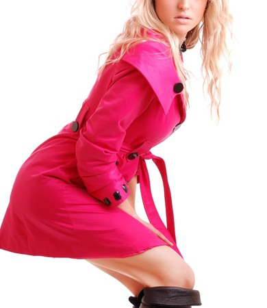 blonde woman in pink coat on white background photo