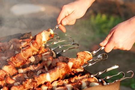 cook preparing barbecue Stock Photo - 6987860