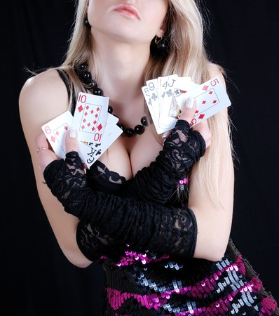 chest hair: picture of a sexy woman holding playing cards