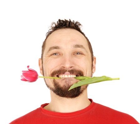 handsome men with the pink tulip in his teeth Stock Photo - 6987834
