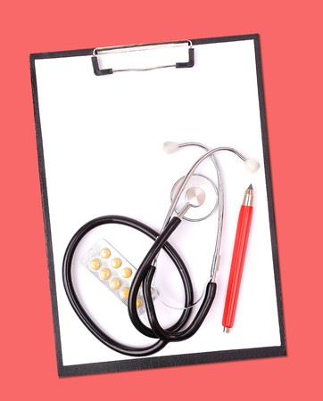 Medical clipboard and stethoscope on red photo