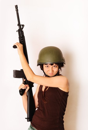 Beautiful army girl holding gun. photo