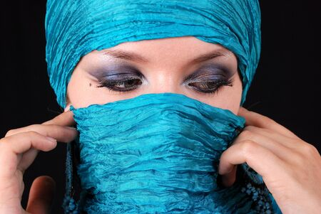 Muslim girl with beautiful blue eyes photo
