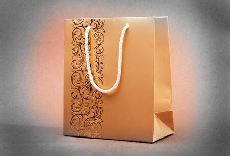 gold paper bag shopper Stock Photo - 7185283