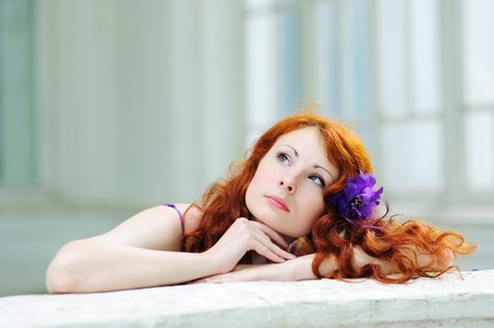 Dreaming woman with a flower in her hairs Stock Photo - 7184870