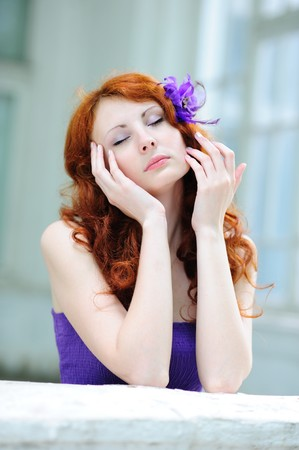 Dreaming woman with a flower in her hairs Stock Photo - 7184873