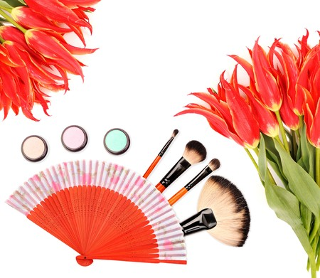 Cosmetics and brushes for a make-up on a white background photo