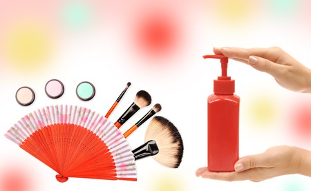 Cosmetics and care tools on a colorful background photo