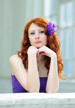 Lovely woman with a flower in her hairs Stock Photo - 7281411