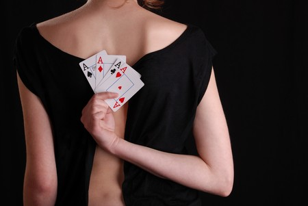 sexy woman holding playing cards, back view Stock Photo - 7331453