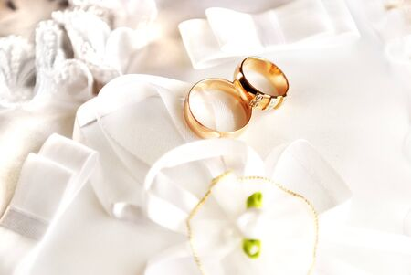 Wedding rings on a satiny fabric with bows Stock Photo - 7422160