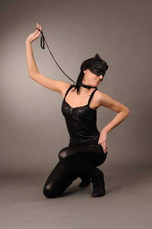 attractive girl in the cats mask, sexual role games. photo