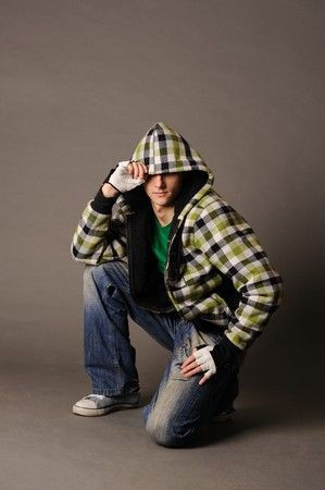Casual cool young guy wearing a hood photo