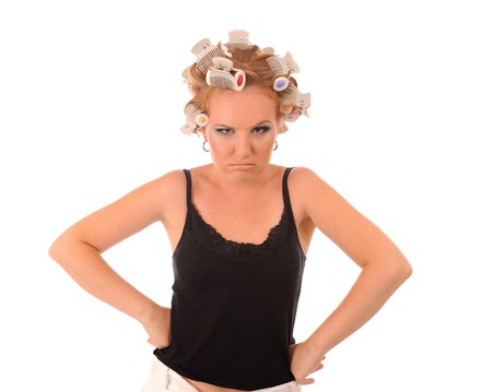 Wicked attractive housewife with curler Stock Photo - 8110586