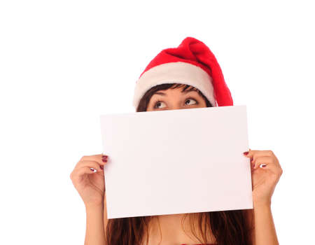 Beautiful female Santa with empty paper. Space for text. photo