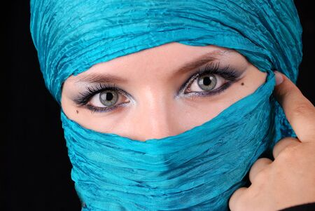 Closeup of blue woman's eyes with east make-up photo