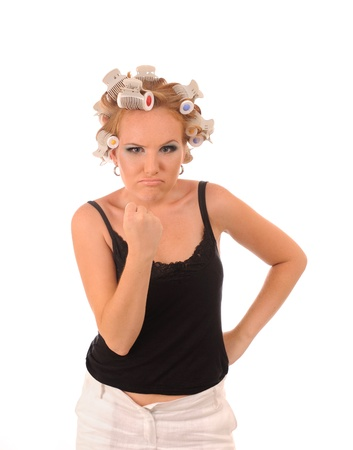 rollers: Wicked attractive housewife threatening fist Stock Photo