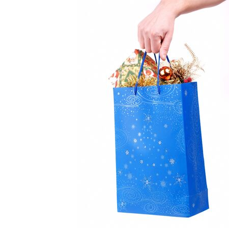 hand hold christmas paper bag with presents photo