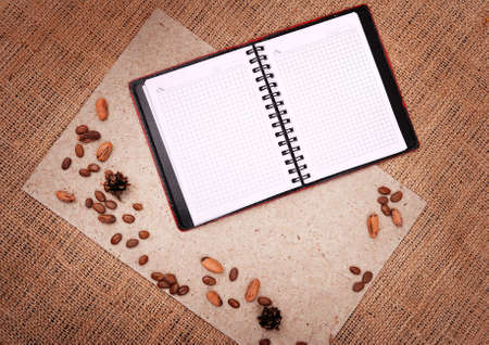sacking: open notebook with nature elements on background of sacking  Stock Photo