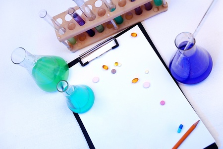 Laboratory research - glass test tubes, tablets and the form photo
