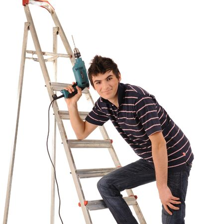 Young attractive repairman worker, isolated on white. photo