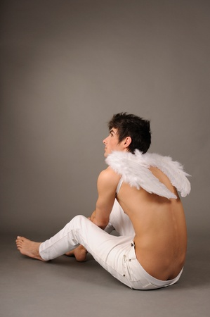 male angel: Handsome male angel, studio shot. Stock Photo