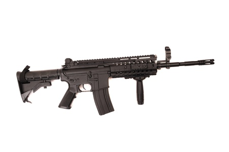 airsoft: Full length automatic assault rifle isolated on white.