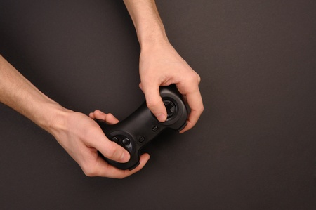 Hands holding a wireless gaming controller, isolated on white.  photo