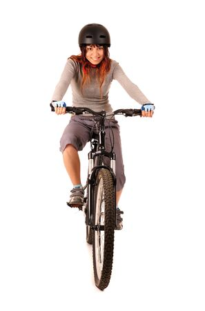 Young smiling woman bicyclist isolated on white Фото со стока