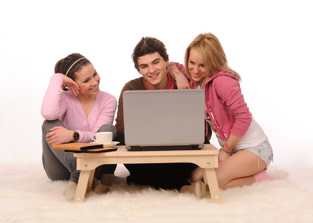 Group of students having fun with laptop on white background. Stock Photo - 8669039