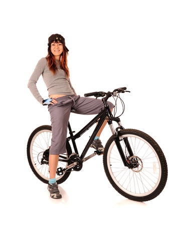 rapidity: Young smiling woman bicyclist isolated on white Stock Photo