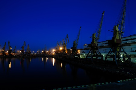seaport: View on seaport with cranes at the night. Stock Photo