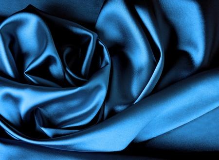 Smooth elegant dark blue satin background. photo