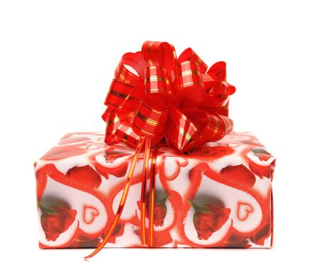 Gift box with hearts decorated with red bow isolated on white. photo