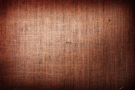 brown: Fragment of rough brown textile background