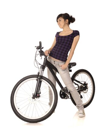 bicycling: Young woman bicyclist isolated on white, studio shot. Stock Photo