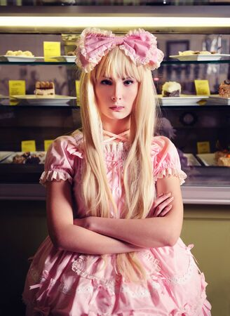 Young beautiful offended woman with a cakes.  photo