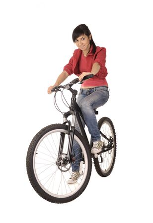rapidity: Young woman bicyclist isolated on white, studio shot. Stock Photo